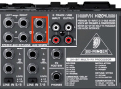 Aux Sends highlighted on a Behringer Xenyx X1204 mixer